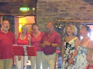 Rapsquillion singing at Folk in the Sauna, Tintern, July 2013